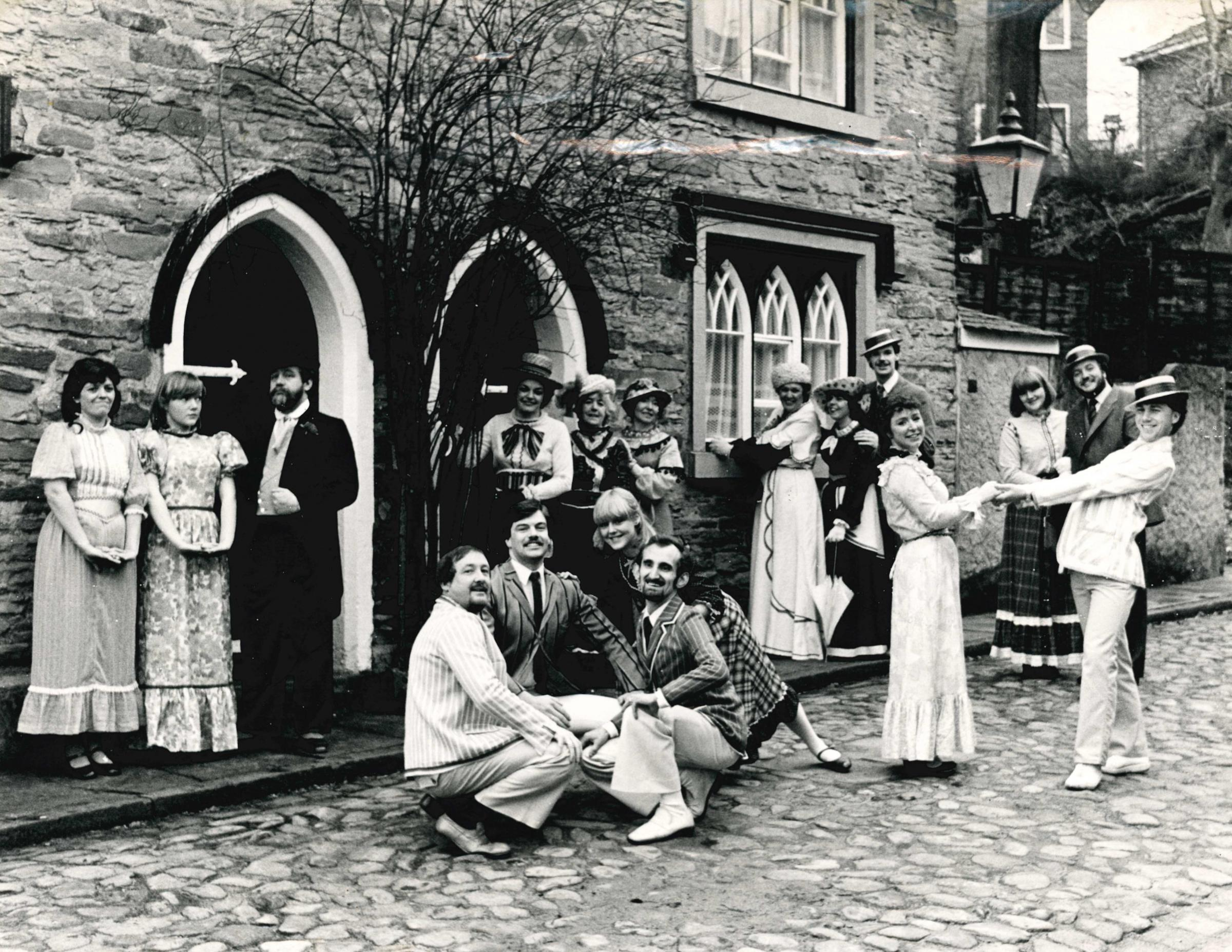 Members of St Philip's AODS taken outside the birth place of Samuel Crompton in Firwood Fold, Bolton, to promote Half a Sixpence. February 1982. Picture by Arnold Pennington