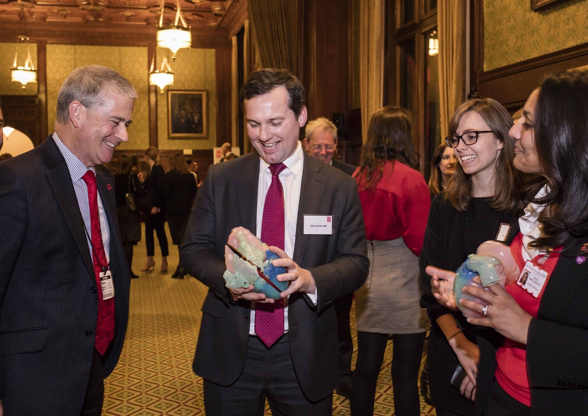 Chris Green MP with a 3D-printed heart at a reception for the British Heart Foundation