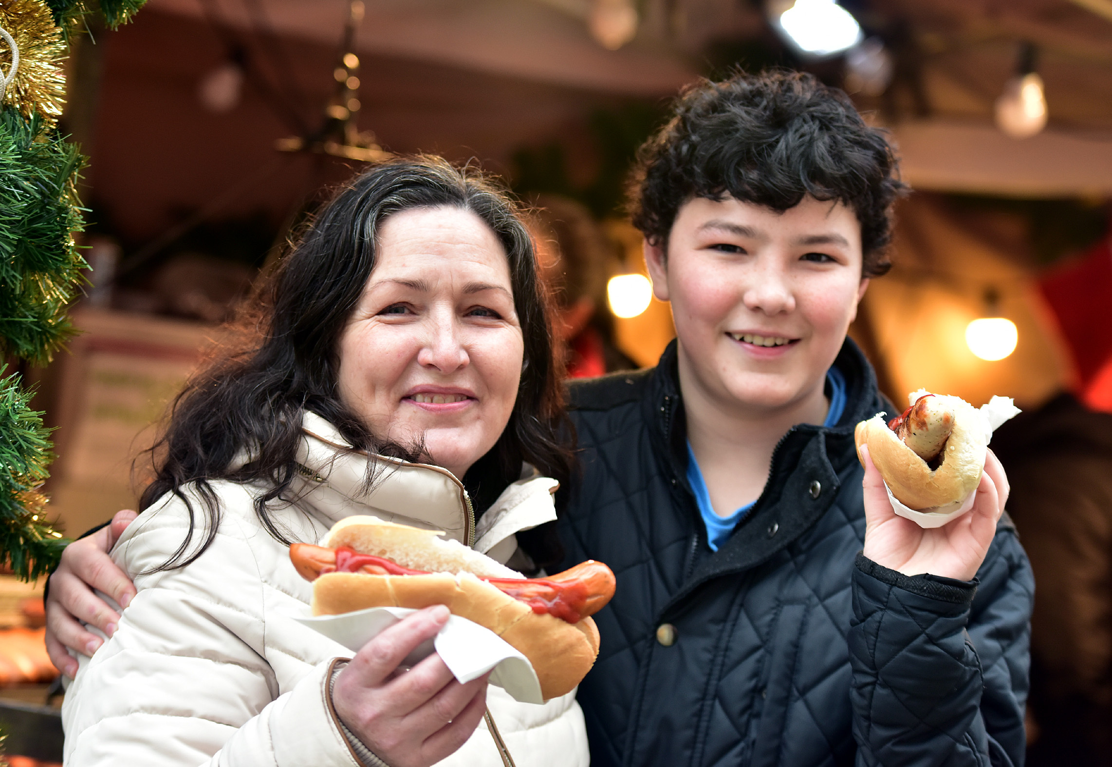 FEAST: Hayley Rowan and her son Tom Thompson, aged 13, enjoy food at the Christmas market in Bolton town centre