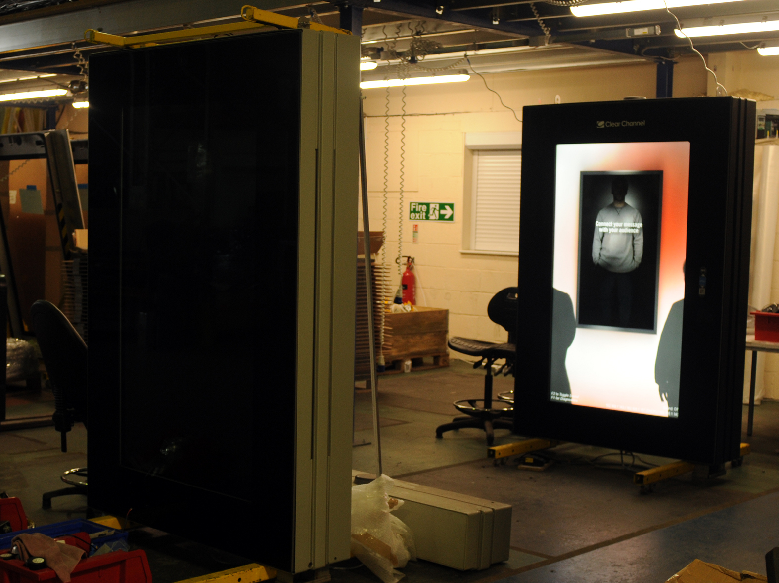 Work on the screens of new phone boxes at the Amscreen factory in Wingates.
