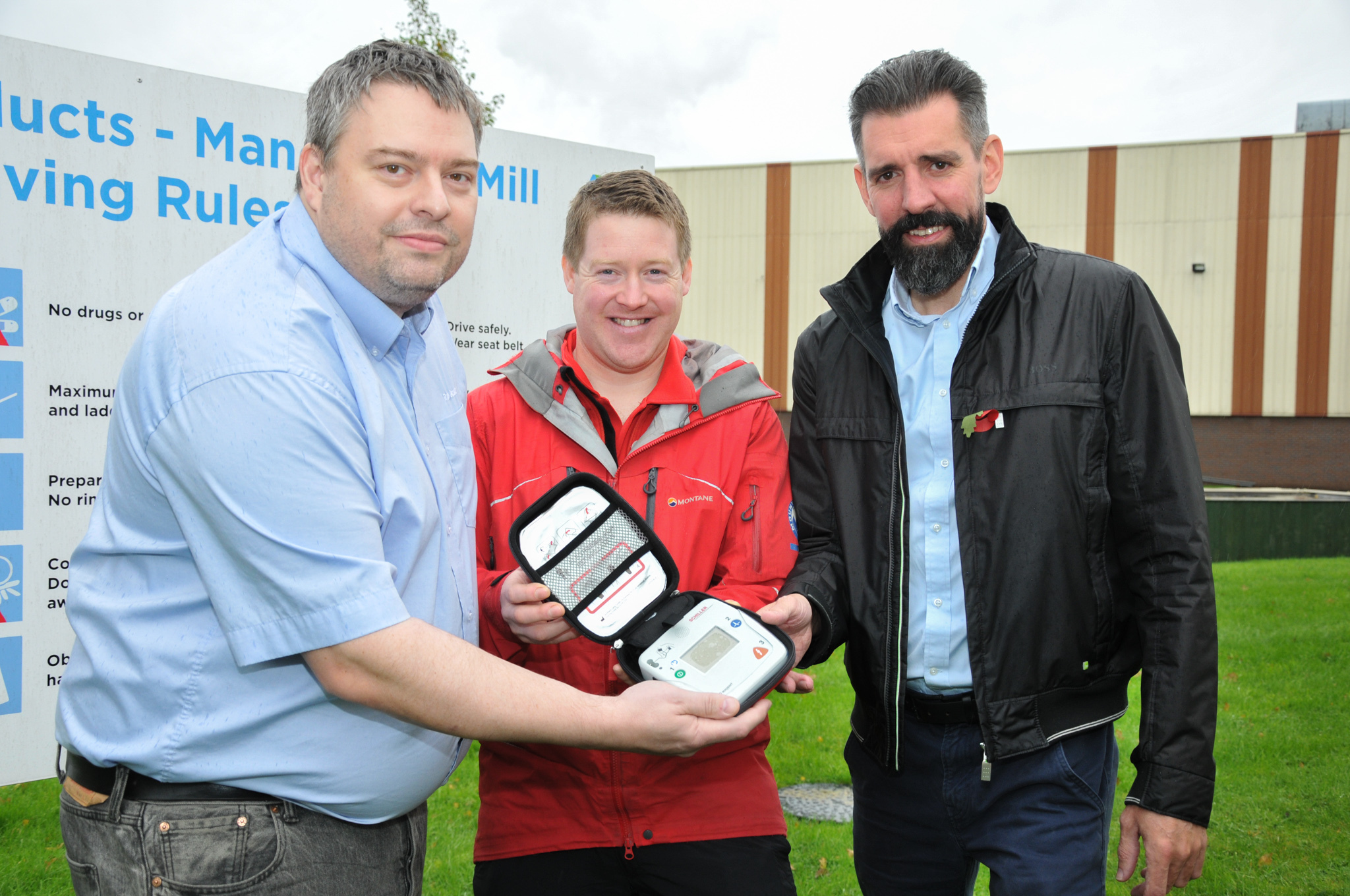 Essity's Rob Greaves, Bolton Mountain Rescue's Steve James, and Essity mill manager Jim Lang with the defib after a £500 donation from Essity
