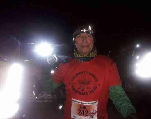 LIGHTING UP THE DARK: Ian Burns finishing the Petzl Nightrunner race at Grizedale Forest