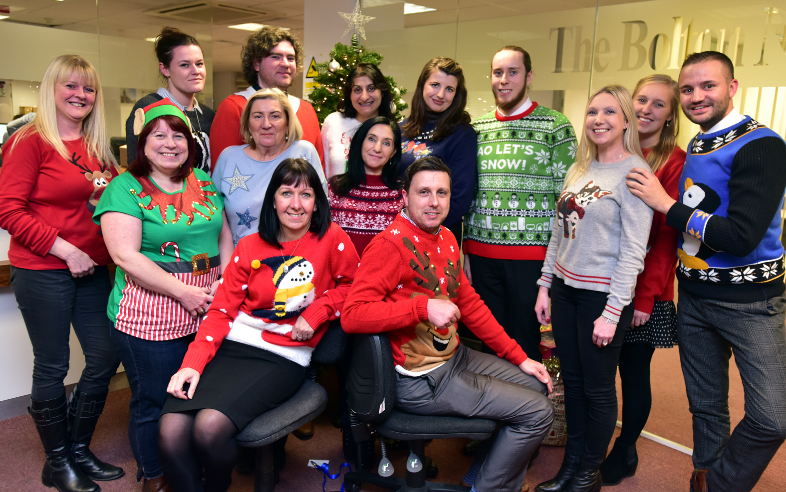 JOLLY: Bolton News staff wearing their Christmas jumpers