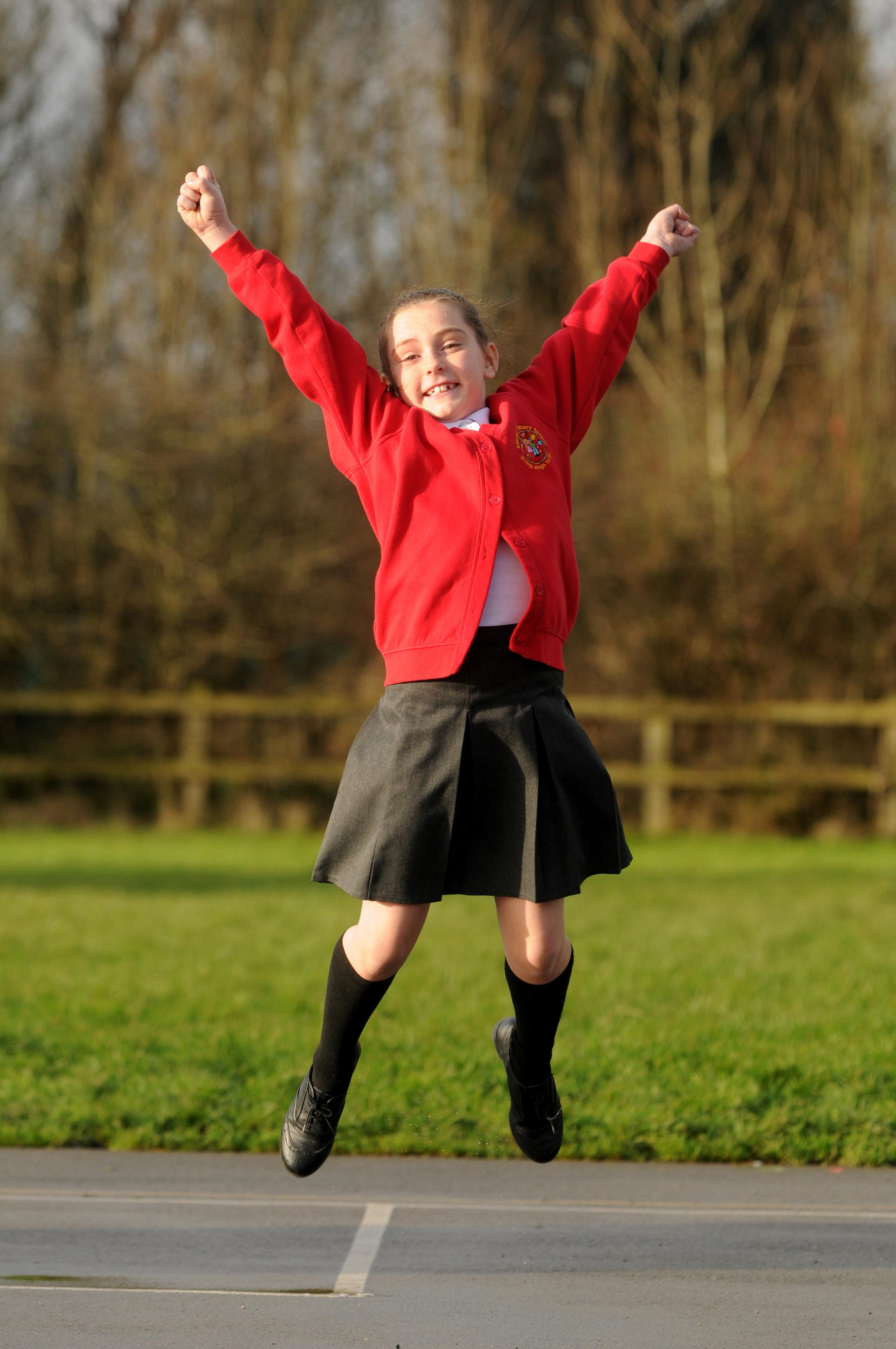 FLYING HIGH: Eatock Primary School pupil Erin Thomas, aged nine, celebrates her school's performance in the primary school performance tables