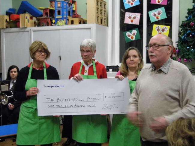 Jeff Sheffield, right, chairman of Trustees of Walmsley Unitarian Chapel, receiving the cheque for £1,000 with Incredible Edible Nature Cafe members Sharon English, Barbara Spence and Jeanne Bilardi