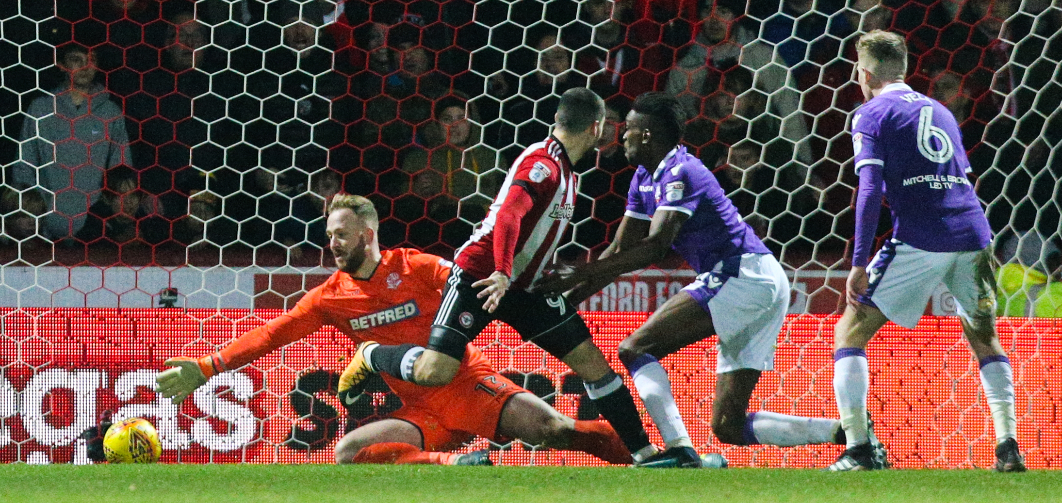 Neal Maupay back-heels Brentford's second goal late in the second half at Griffin Park