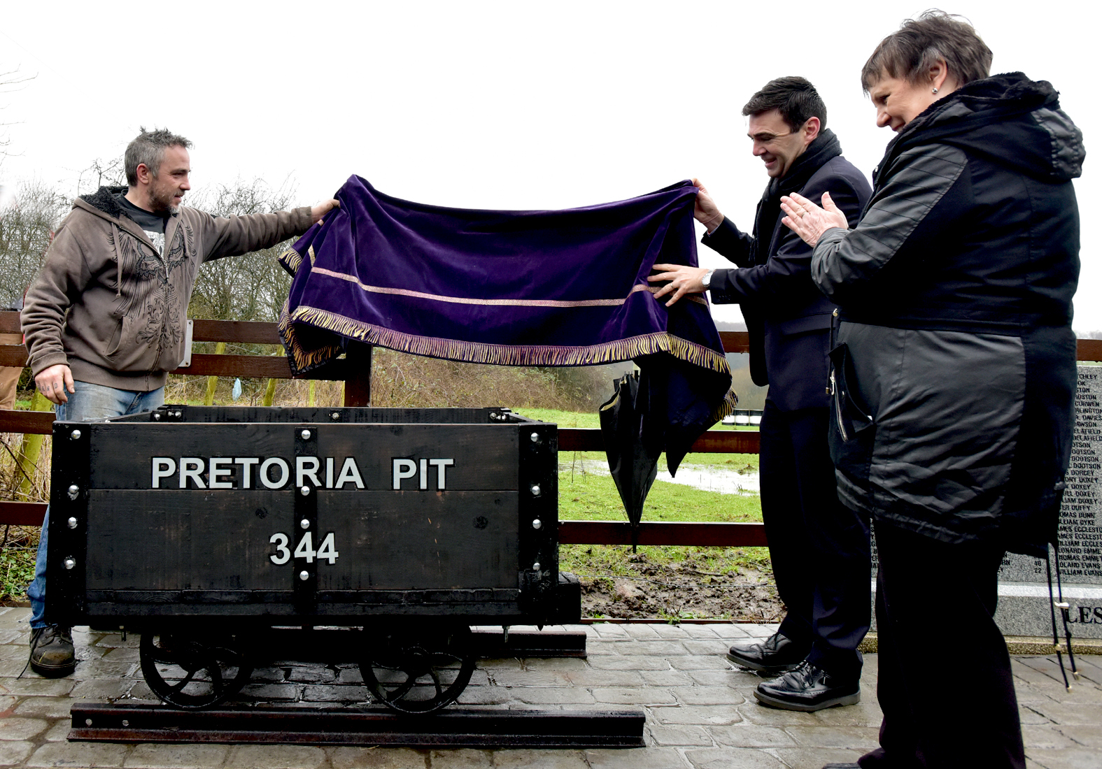 UNVEILING:Sculptor Darren Block, Mayor of Greater Manchester Andy Burnham and Julie Hilling at the unveiling of a replica coal truck at Pretoria Pit memorial