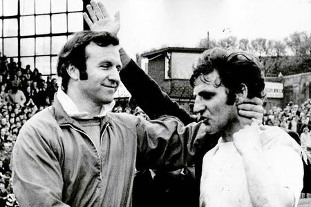 The Bolton News: Warwick Rimmer is shaken by the hand by Wanderers boss Jimmy Armfield after promotion in 1973.