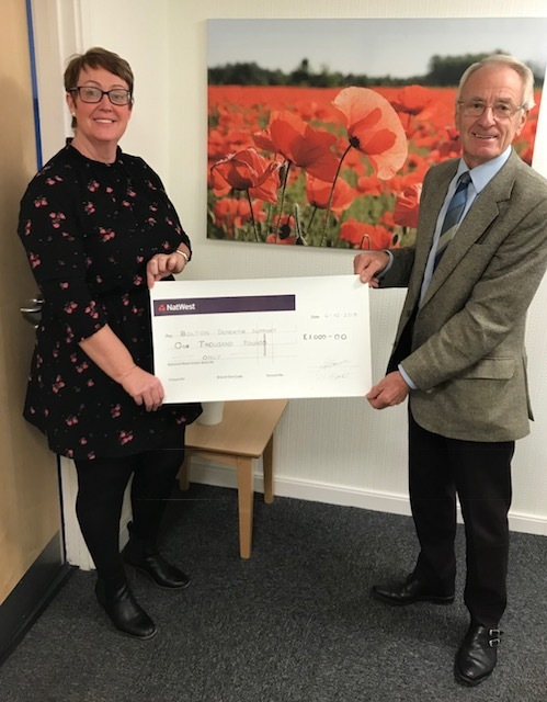 Jack Morris, president of Bolton butcher Association, presents £1,000 to Alison Lowe of Bolton Dementia Support Group