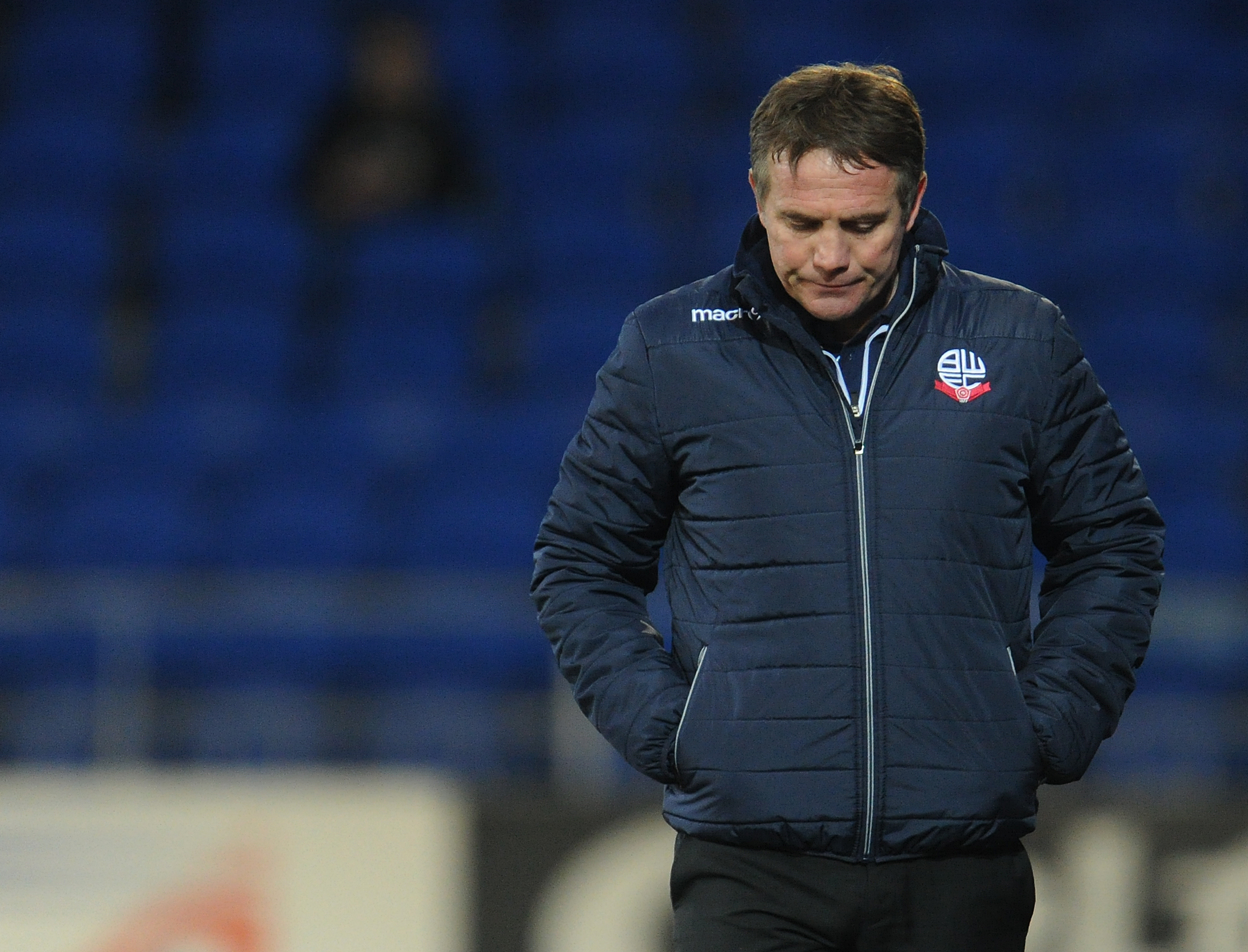 Phil Parkinson looks dejected as Wanderers are beaten 2-0 by Cardiff City