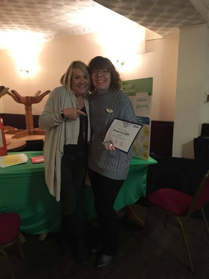 ACHIEVE: Claire Bond, right, is presented with her diamond award by Weight Watchers area manger Louise Horrocks