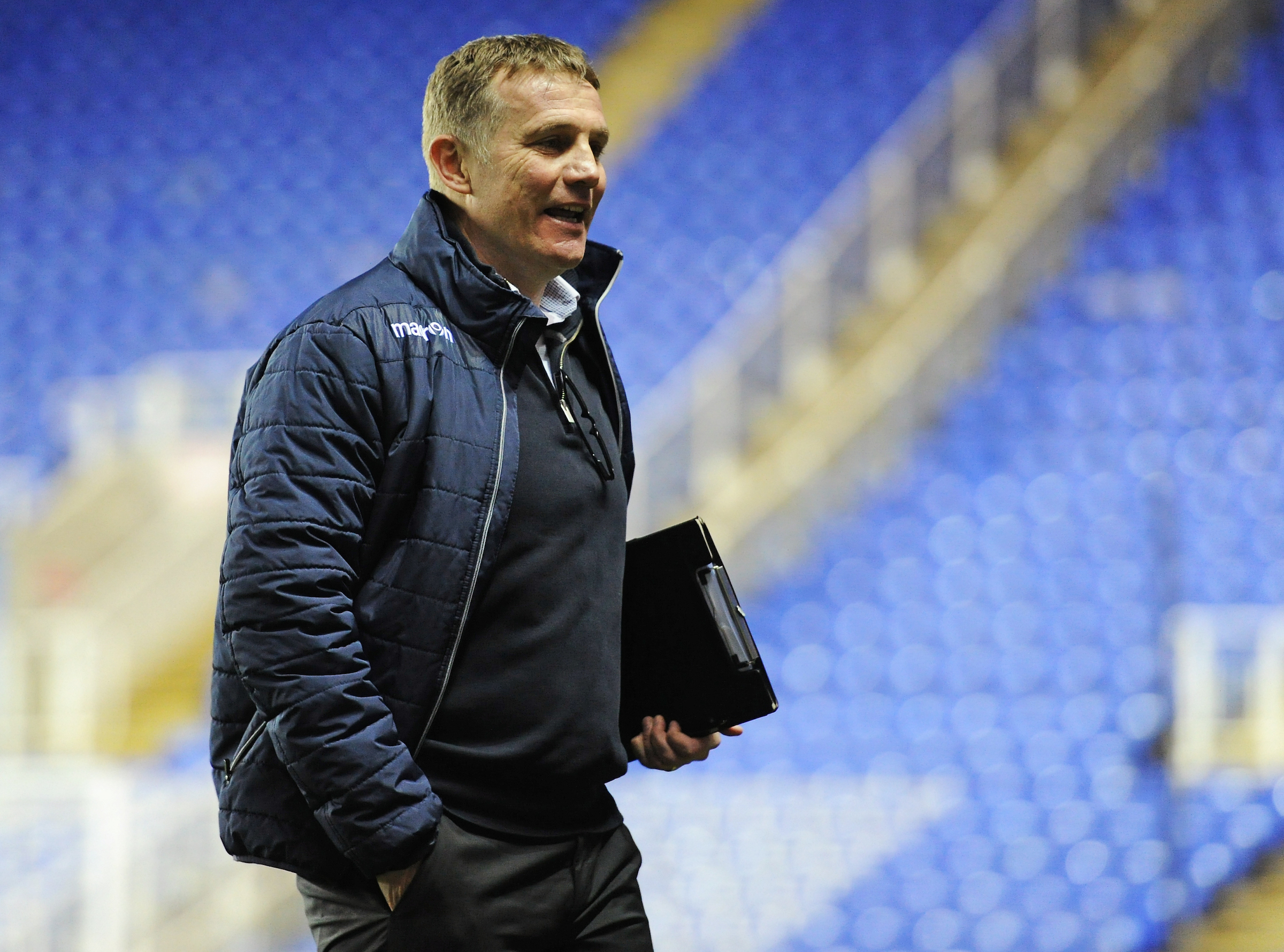 PLAN OF ATTACK: Phil Parkinson walks off at Reading's Madejski Stadium clutching his clipboard after a change of tactical plan on Tuesday night