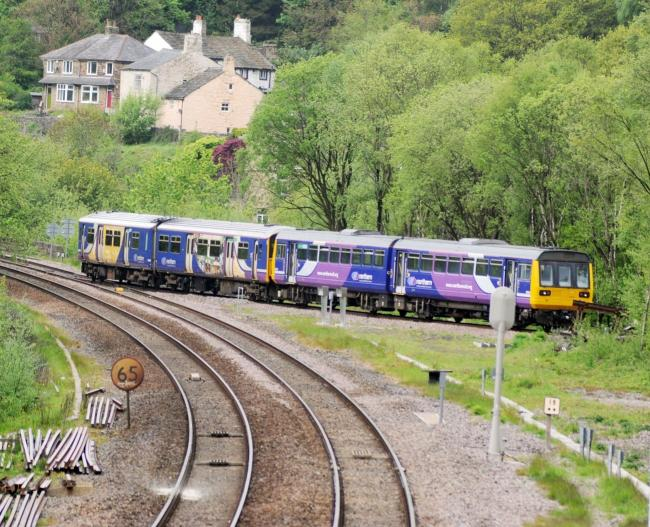 NEIL JOHNSON 17 May 2015.The first trains on the Todmorden Curve en route between Burnley and Manchester Victoria..