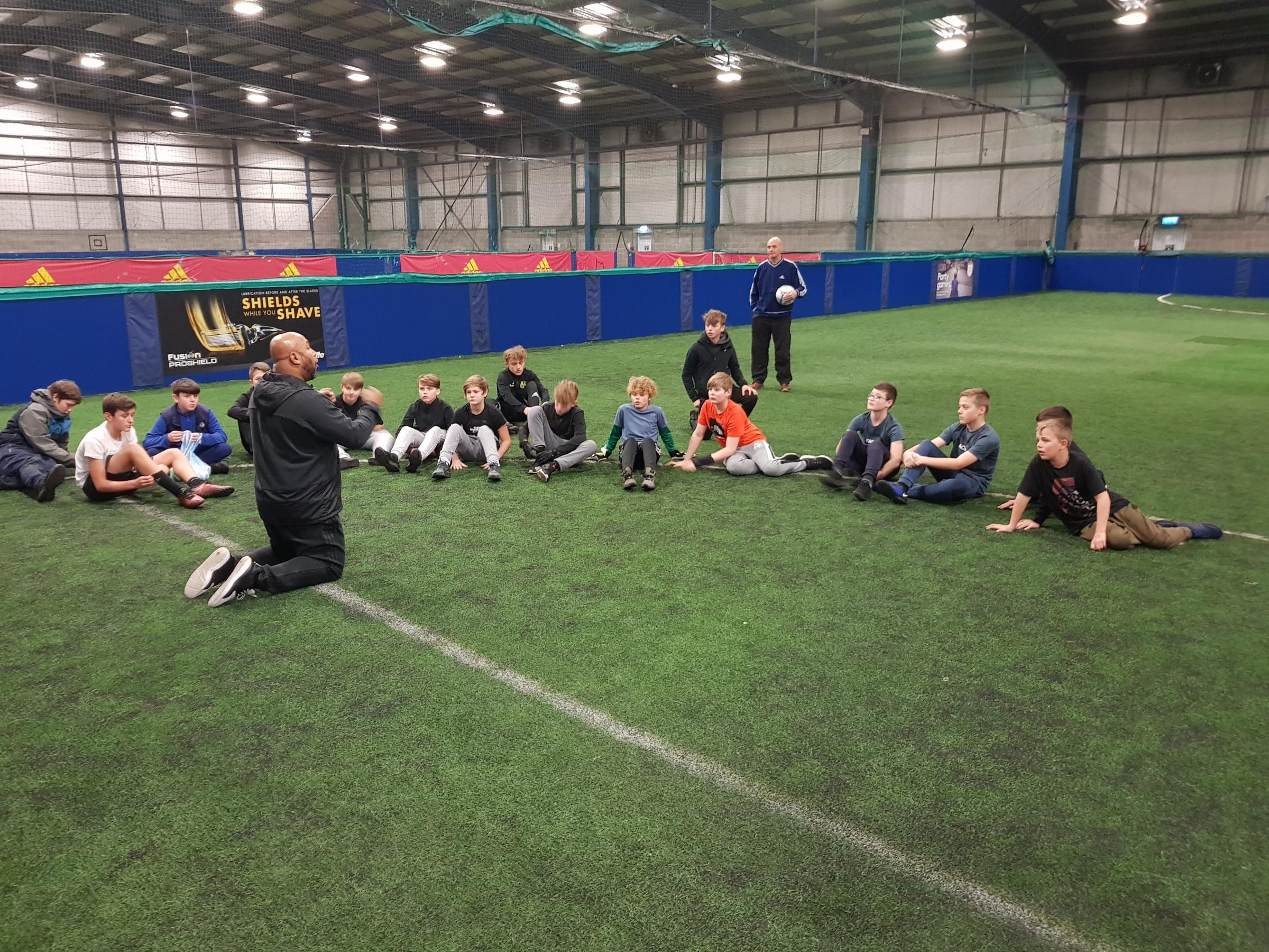 COMMUNITY: Children involved in Raise the Youth's football group