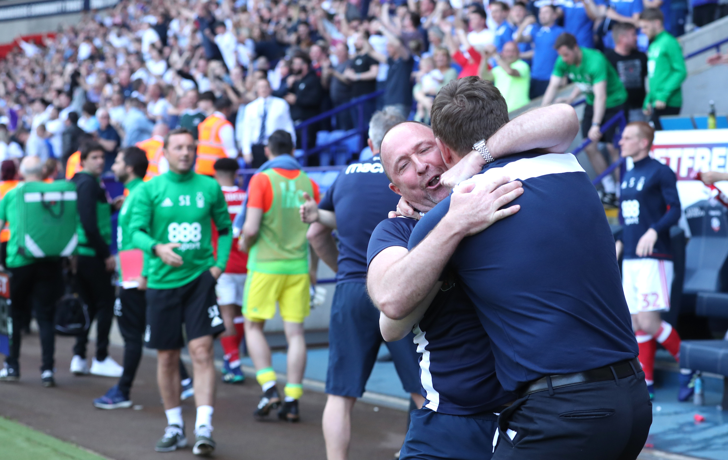 HUGGING IT OUT: Parkinson hugs his assistant Steve Parkin at the final whistle