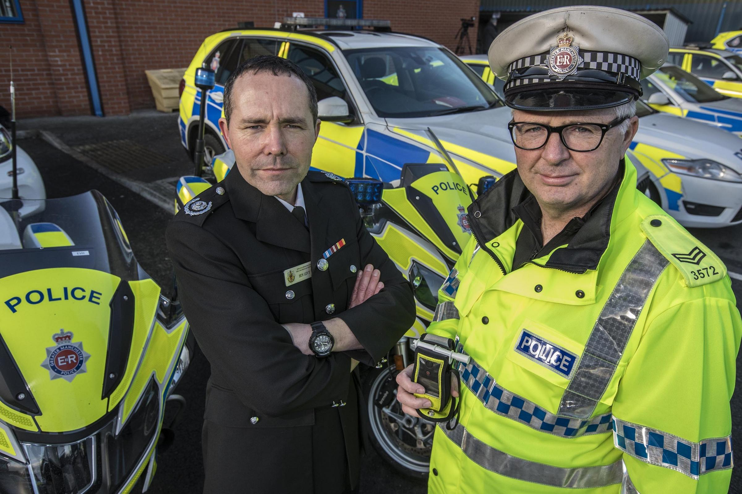 Ben Levy, GMFRS Group Manager, and Sergeant John Brennan, from GMP's Road Policing Unit
