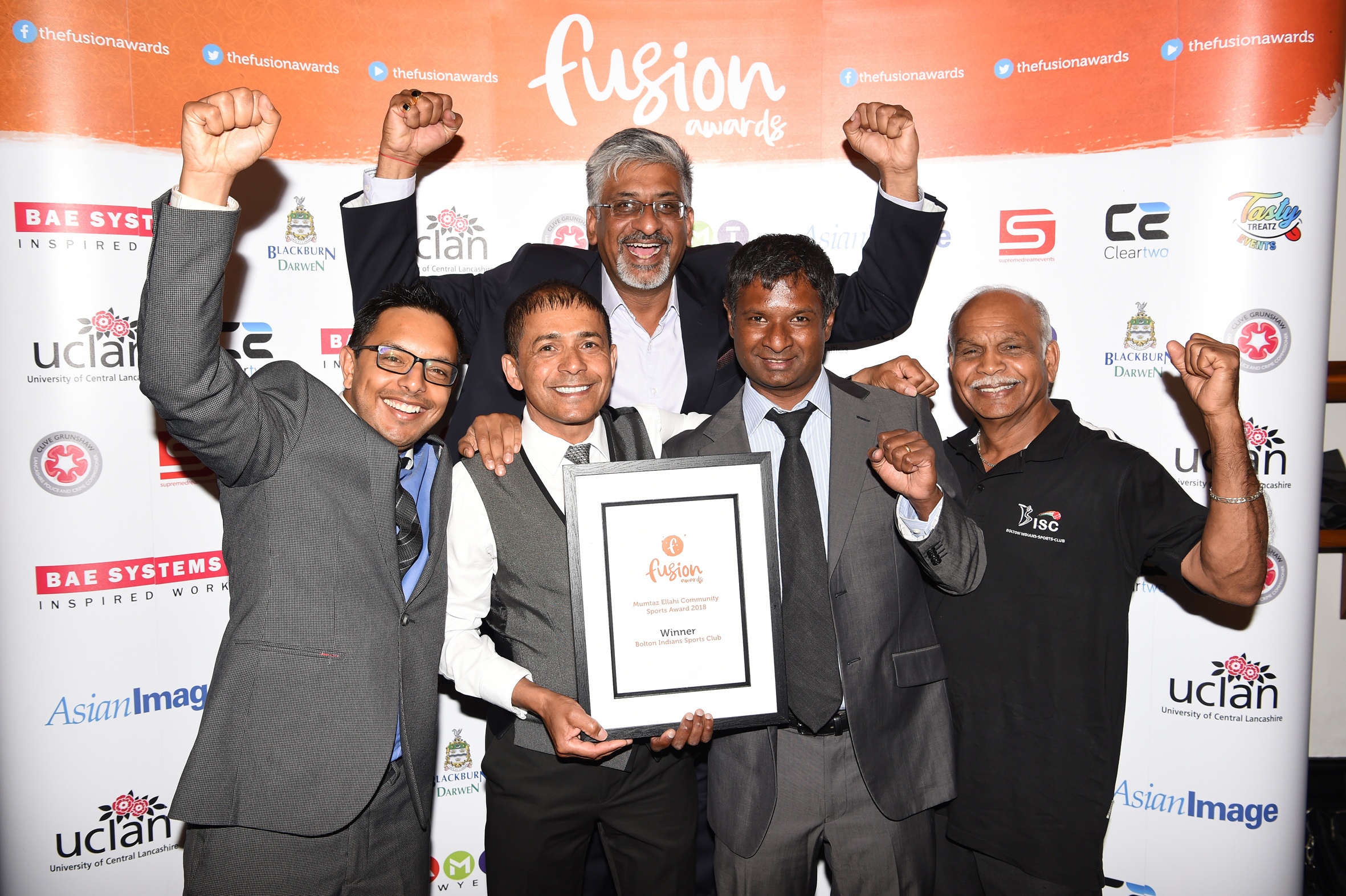 CELEBRATION: Officials and members of BISC with the award