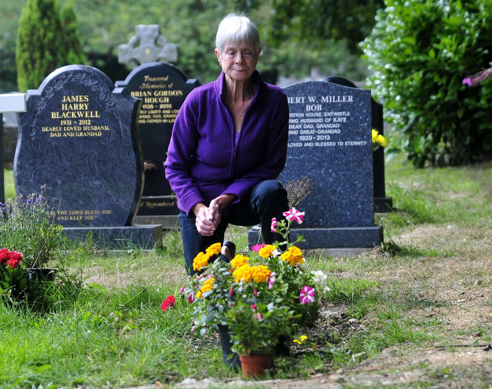 Enid Mort at the grave of her husband Bryan.