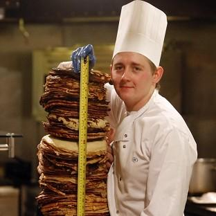 The Bolton News: Chef Sean McGinlay attempts a world record to create the world's tallest pancake stack
