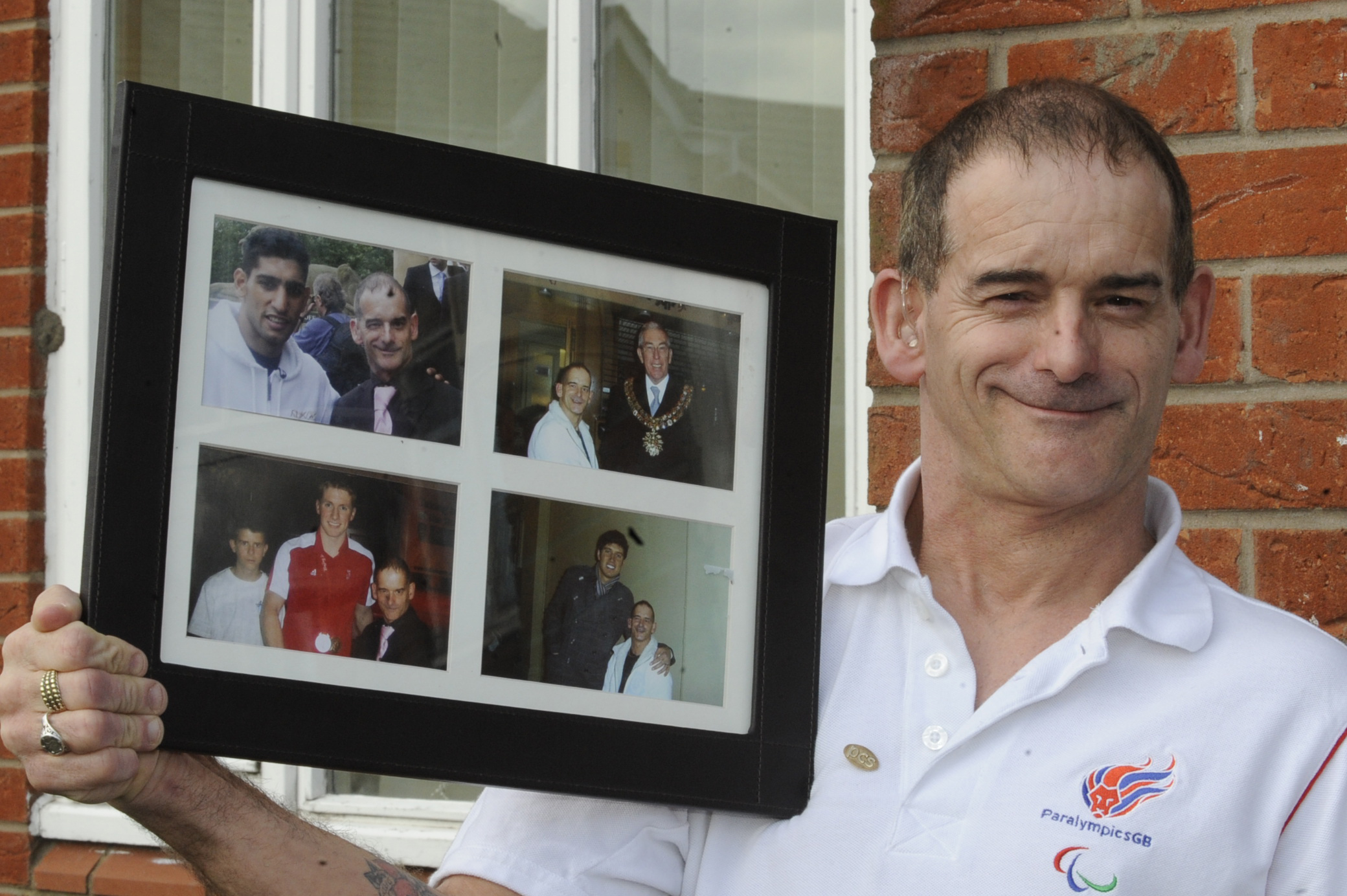 Tony holding a picture of himself with, clockwise, from top left: Amir Khan, the Mayor of Bolton, Cllr Anthony Connell, Vernon Kay and Jason Kenny