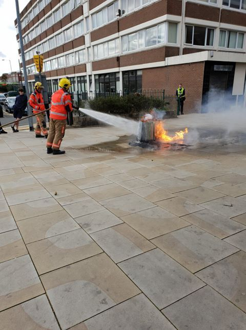 BIN: Fire crews tackle the bin fire in the town centre