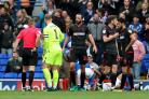 Referee Stephen Martin reaches for his pocket to send off Wanderers' Marc Wilson at Ipswich
