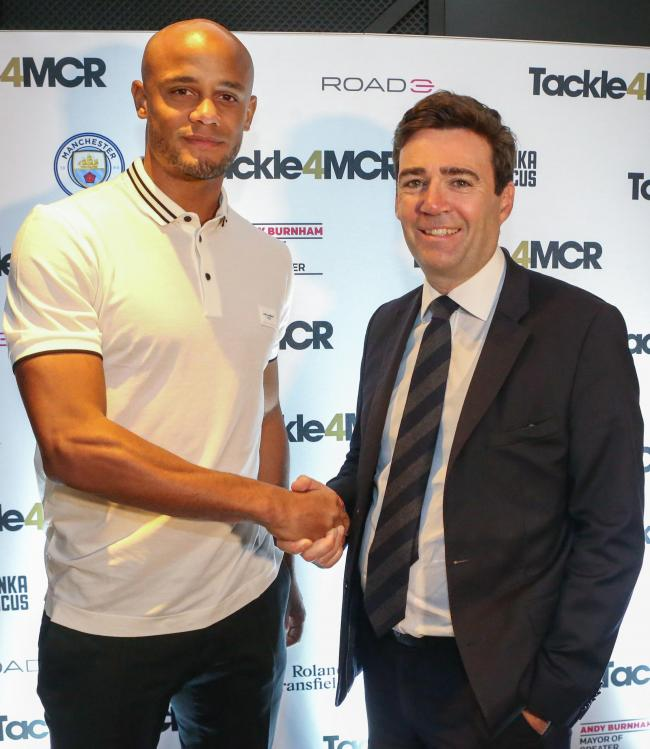 Undated handout photo issued by Tackle4MCR of Andy Burnham, the mayor of Greater Manchester (right) and Premier League football star Vincent Kompany who will donate proceeds from his testimonial season to tackle rough sleeping in Manchester. PRESS ASSOCIA
