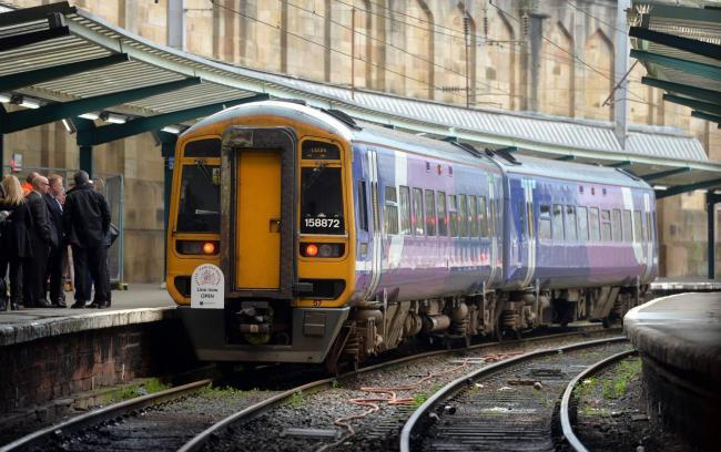 Commuters are facing delays of about an hour on train services in and out of Manchester