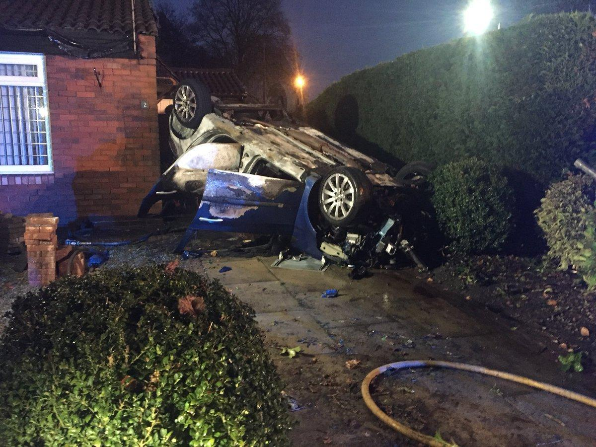 Renault Clio Lands On Roof In Ribchester Drive Driveway On Fire