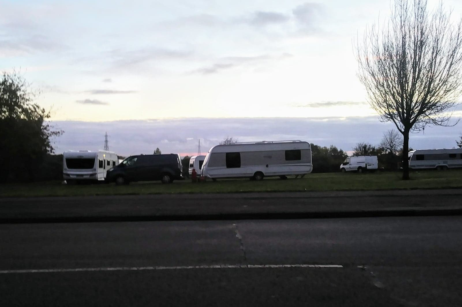CAMP: Travellers at the Highfield Road site in Farnworth for the second time in a month