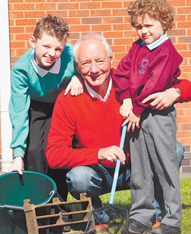 The Bolton News: FISHING FOR FROGS: Fred Ramm and his grandsons Ellis and Kane Harper, aged nine and six