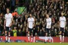 The Bolton Wanderers players look dejected after Norwich score a late winner