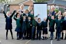 Youngsters and teachers at St James, Daisy Hill celebrate their success in the school league tables