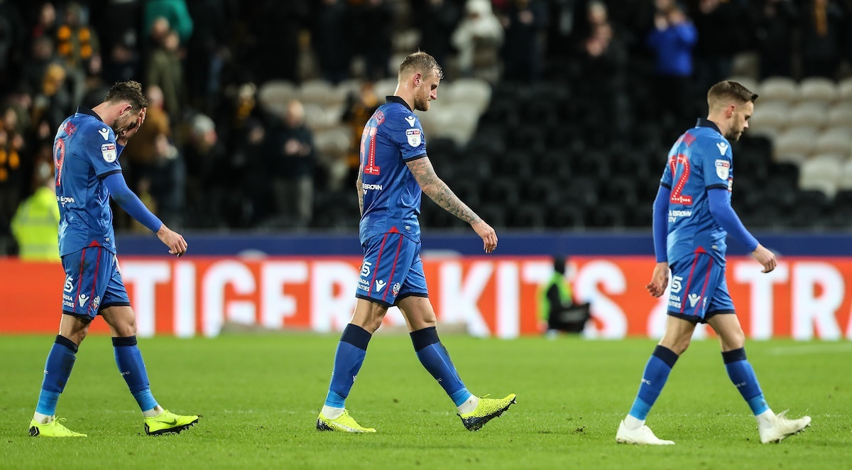 UNHAPPY NEW YEAR: From left, Christian Doidge, David Wheater and Craig Noone trudge off after huniliation at Hull