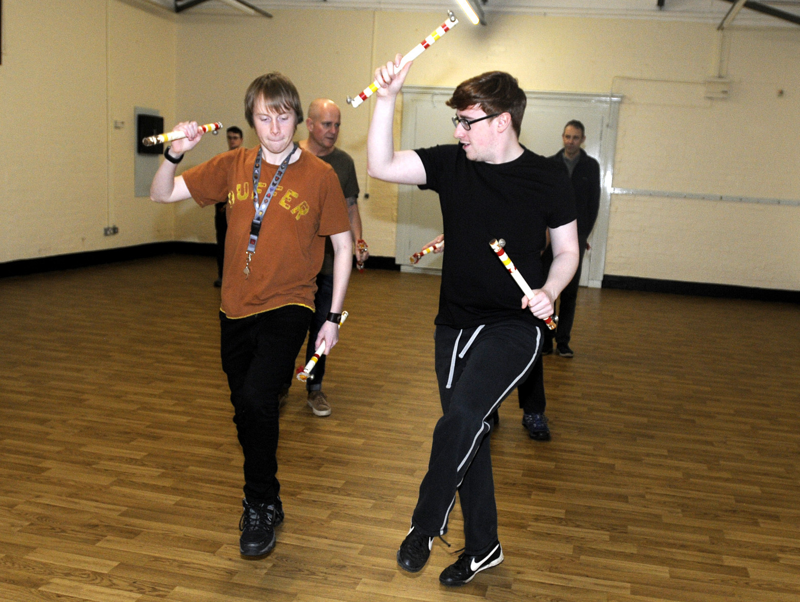 Bolton News reporter Thomas Molloy is put through his paces by Richard Hall when he tried Morris dance fitness with the Horwich Prize Medal Morris Men.