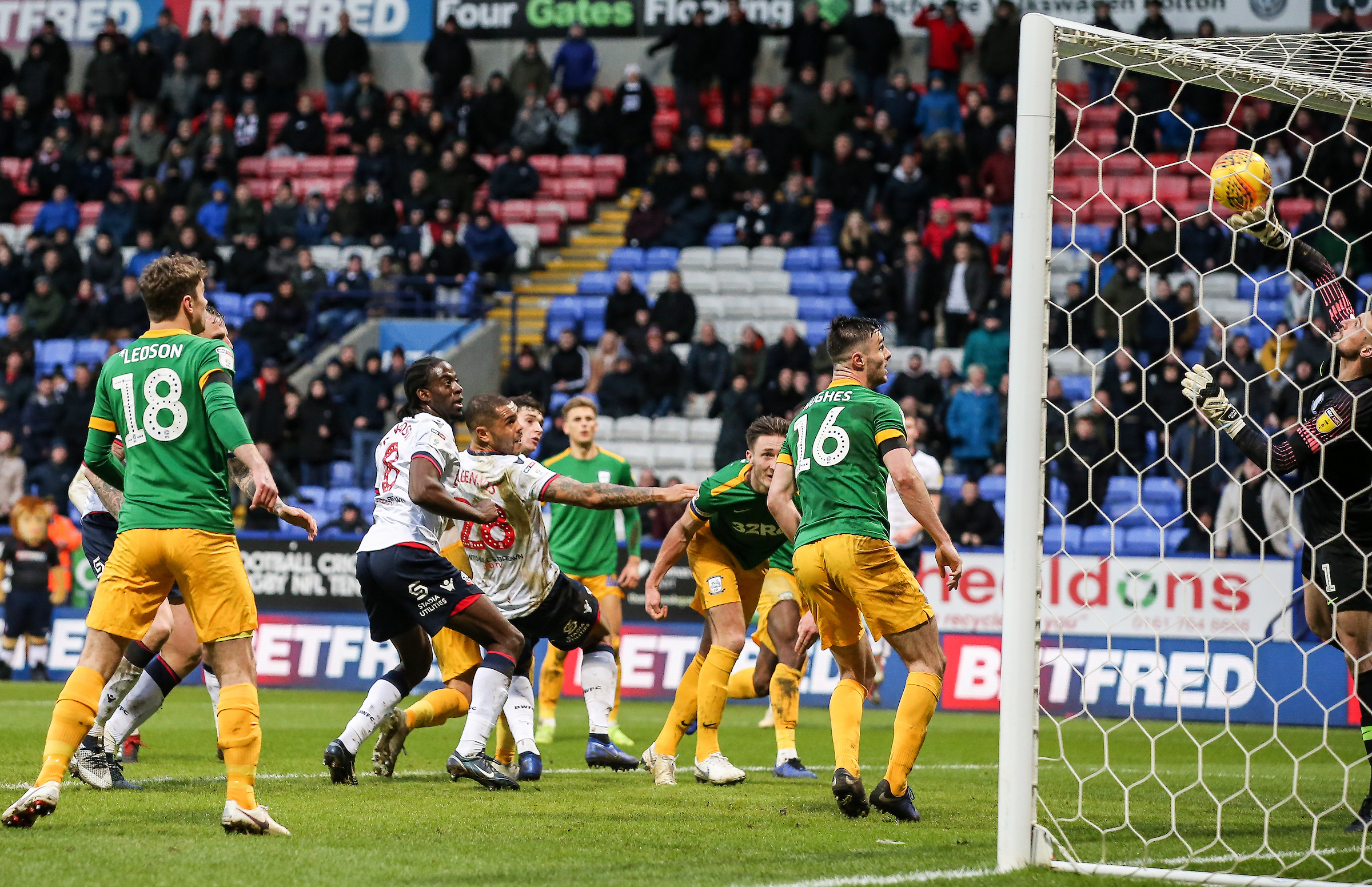 Declan Rudd makes a late save from Josh Magennis in Wanderers' 2-1 defeat to Preston