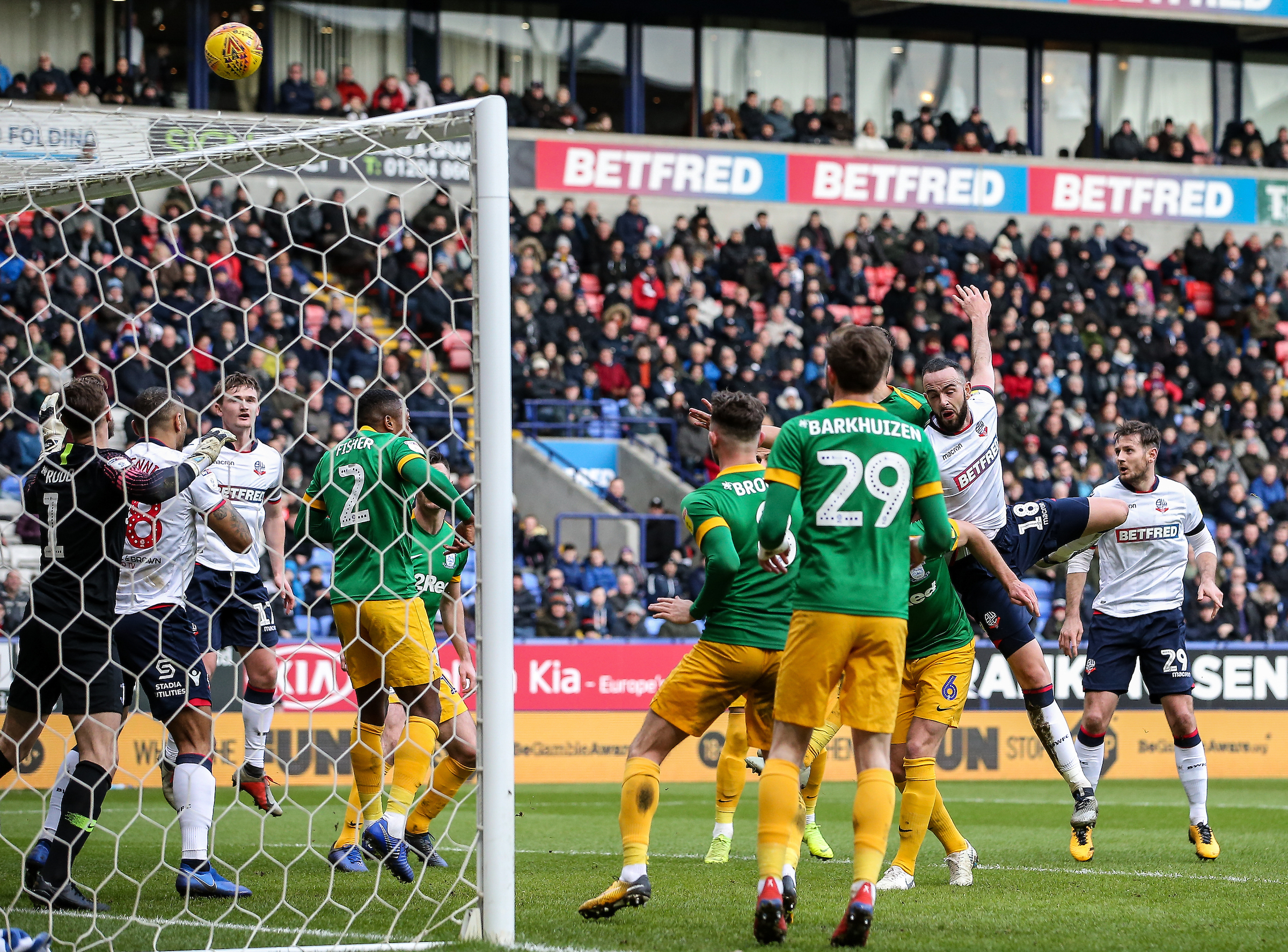 Marc Wilson heads for goal in Wanderers' 2-1 defeat against Preston
