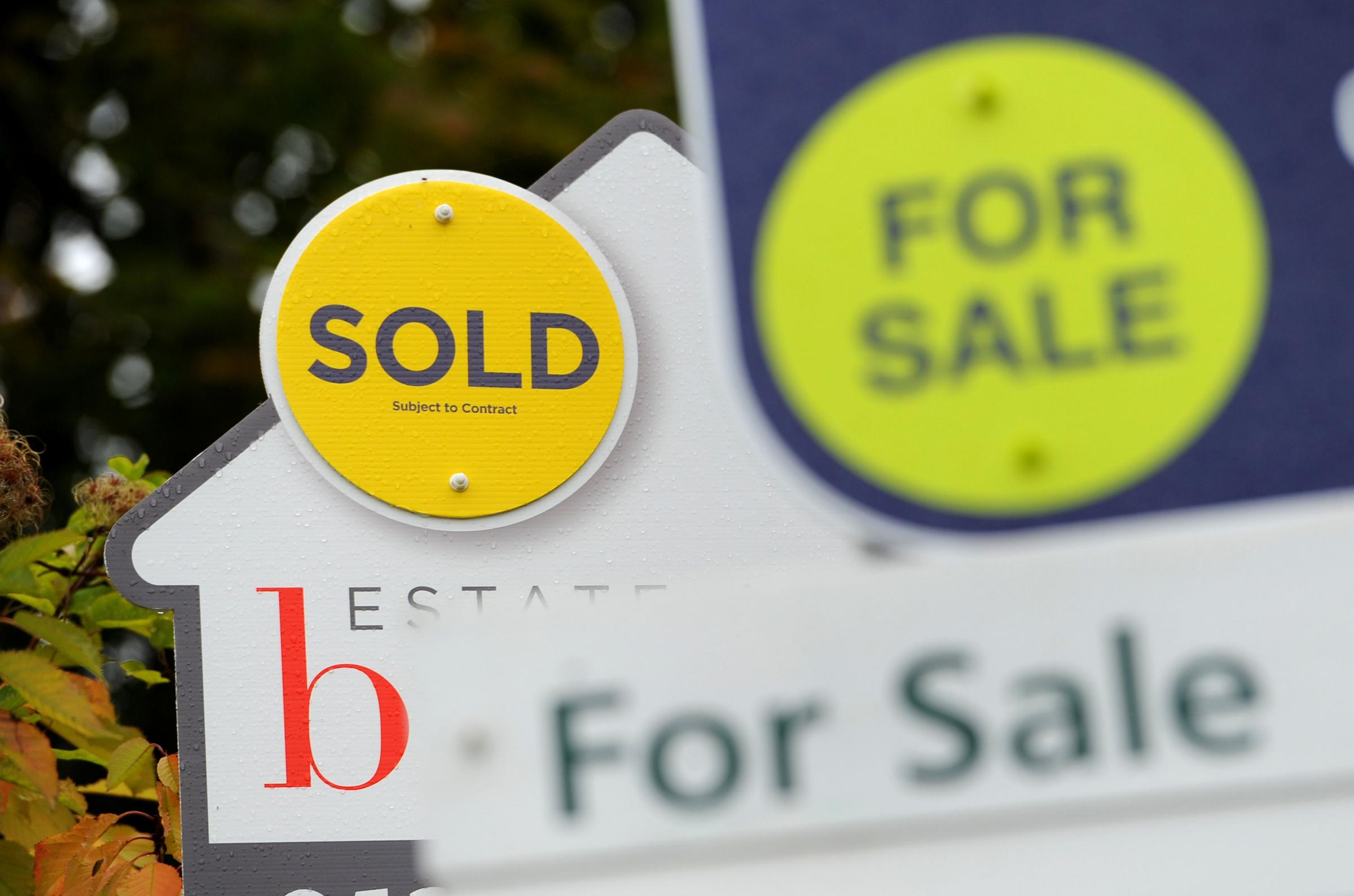 File photo dated 14/10/14 of Sold and For Sale signs. Annual house price growth has slowed to its lowest levels since May 2013, according to an index..