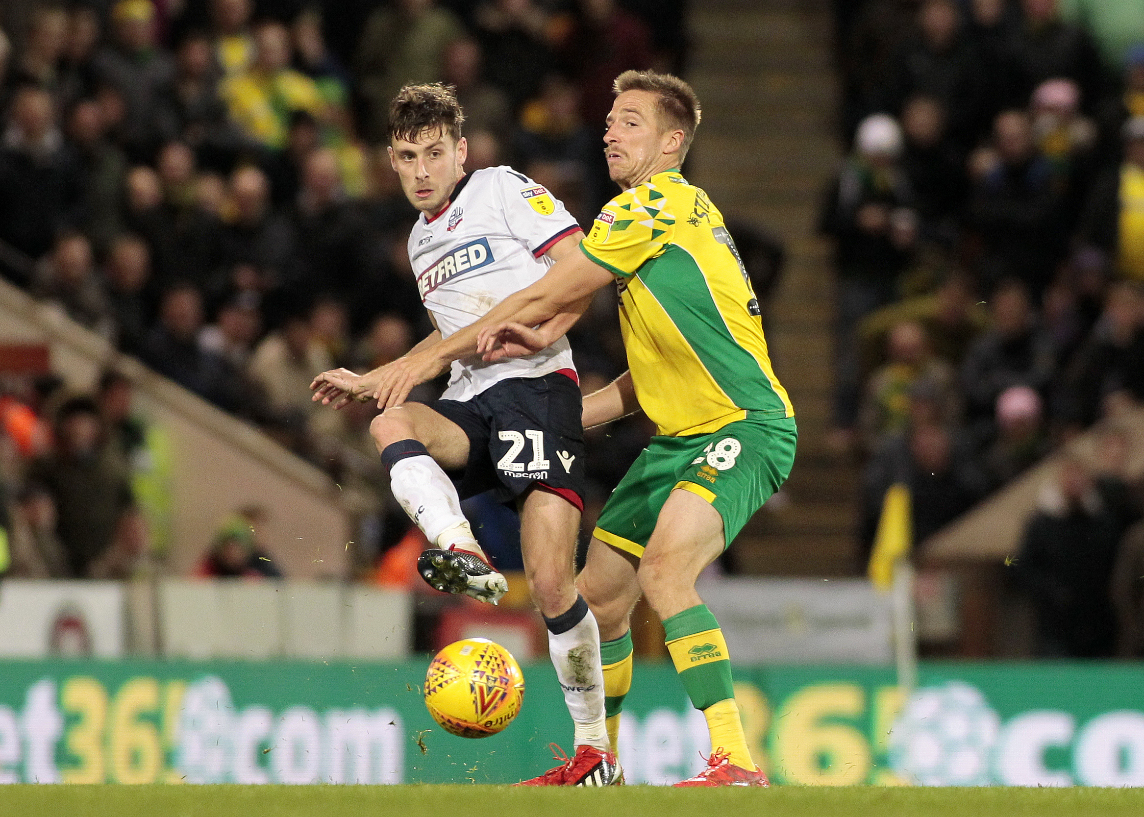 Bolton Wanderers' Joe Williams gets away from Norwich City's Marco Stiepermann  Photographer David Shipman/CameraSport  The EFL Sky Bet Championship - Norwich City v Bolton Wanderers - Saturday 8th December 2018 - Carrow Road - Norwich  World Copy