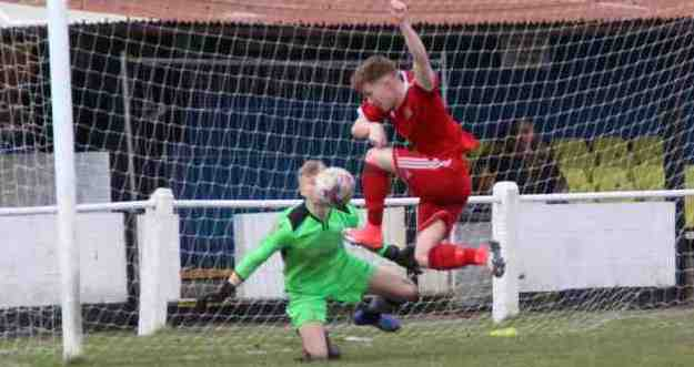 SELF-RAISING FLOWERS: Daisy Hill goalkeeper Ryan Tweddle cannot stop Will Shawcross scoring for Prestwich Heys on Saturday. Brian Hart's side fought back from 2-0 and 3-1 down to chalk up their third straight draw. Picture by Christina Openshaw