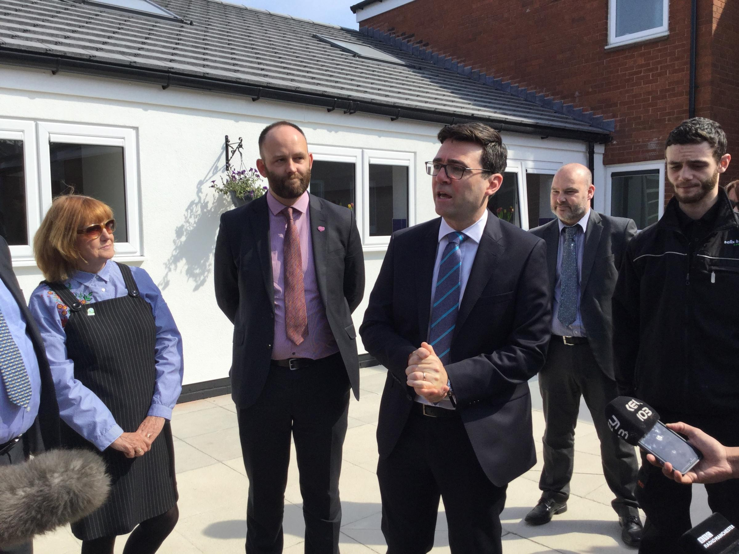 Andy Burnham announcing that Salford mayor Paul Dennett will lead the rewrite of the Greater Manchester Spatial Framework.