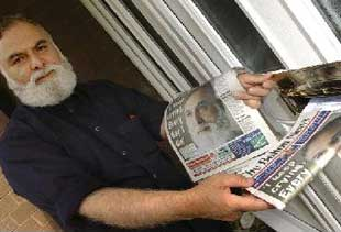 MY STORY: Mumtaz Chishti with copies of Monday's The Bolton News which he delivered to homes in the area where he used to live