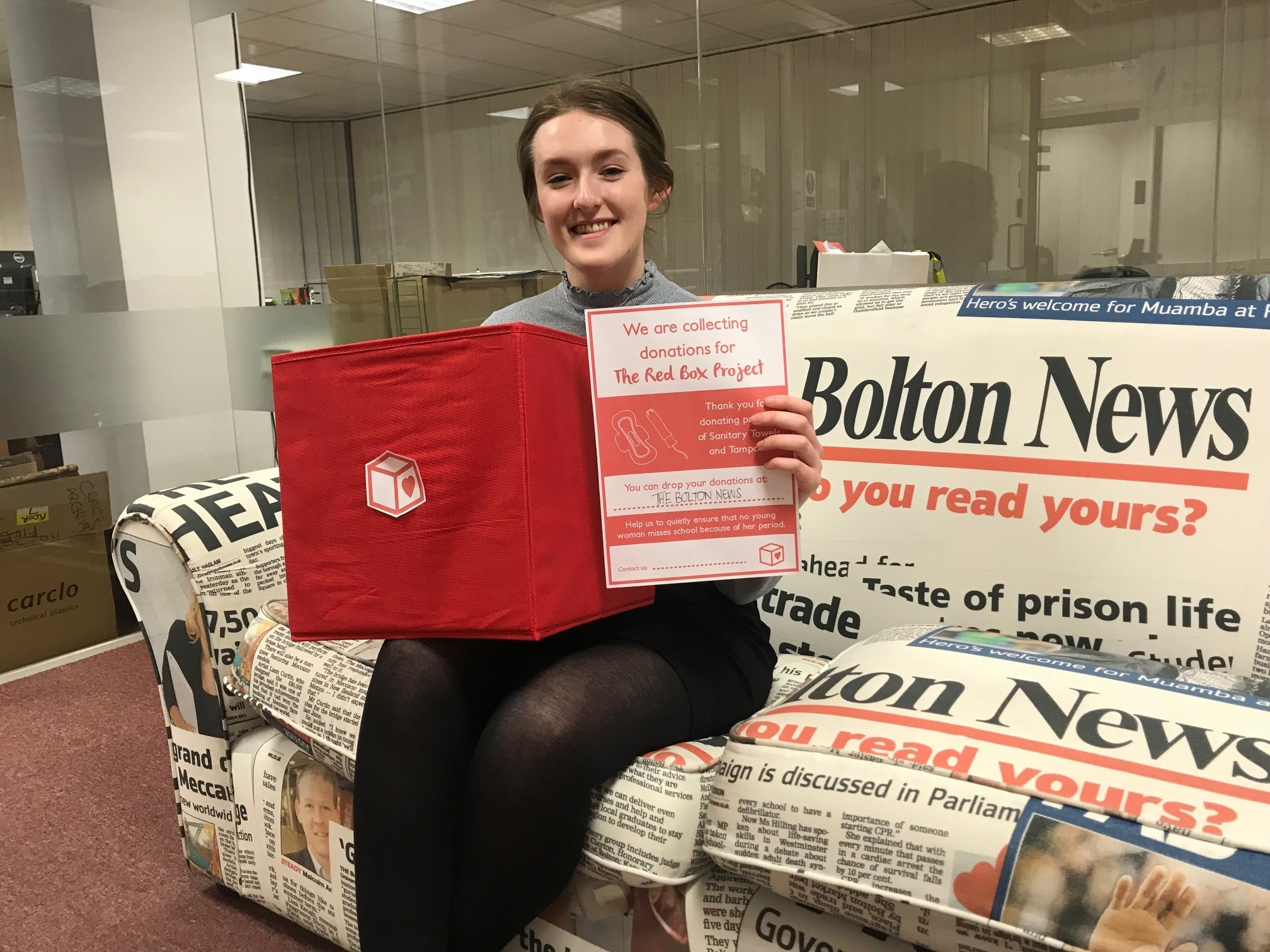 Reporter Helena Vesty with the new donation box for sanitary products at The Bolton News