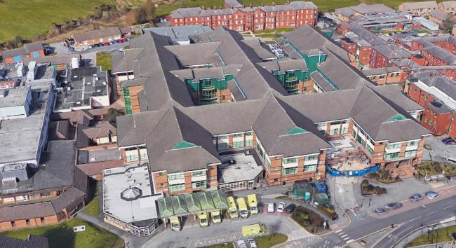 AERIAL: Royal Bolton Hospital, where some of the policy changes will come into effect, as pictured from above