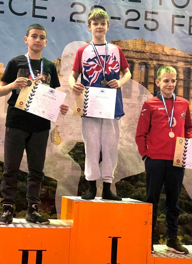 GOLDEN BOY: Charlie Meadows, centre, on the podium in Greece