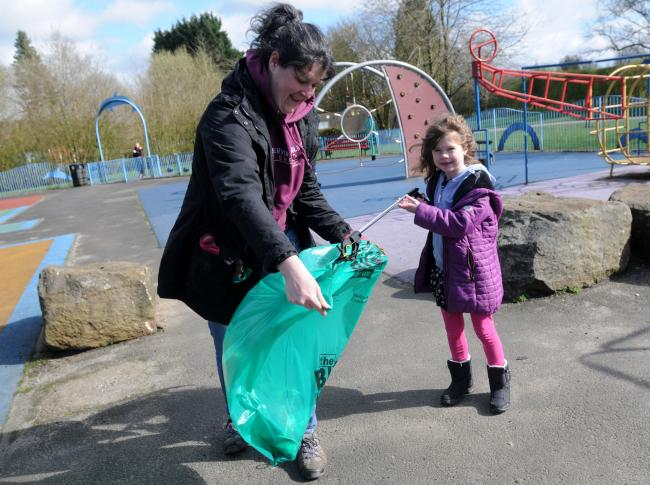 Alison and Erin Green aged 6 take part in a litter pick at Longsight Park, Harwood.