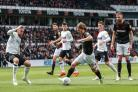 Luca Connell on the ball in Wanderers' 4-0 defeat to Derby County