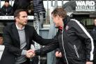 BIG DIFFERENCE: Wanderers manager Phil Parkinson is greeted by Derby counterpart Frank Lampard on Saturday