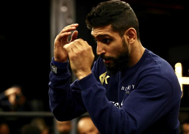 The Bolton News: Amir Khan will go for glory again in New York on Saturday night. Picture: Mikey Williams /Top Rank