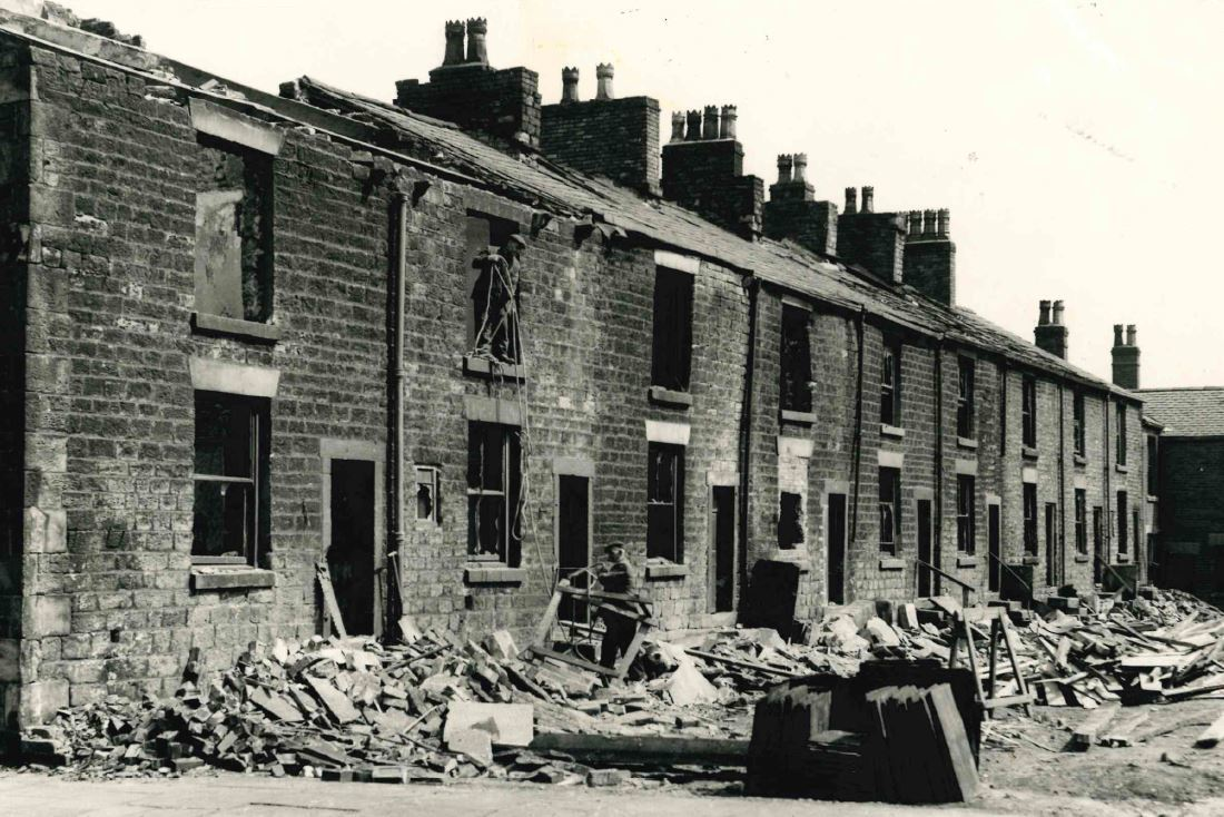 Workers get on with demolition work back n 1963